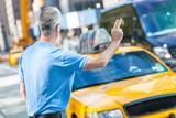 Fototapety Senior Man Calling a Cab in New York