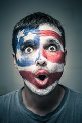 Surprised man with US flag on face