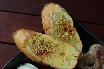 Garlic bread on steak recipe.