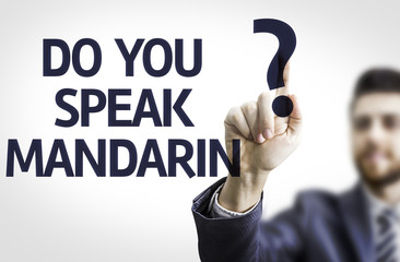Business man pointing the text: Do you Speak Mandarin?
