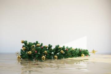 Umgekippter Weihnachtsbaum im Wasser