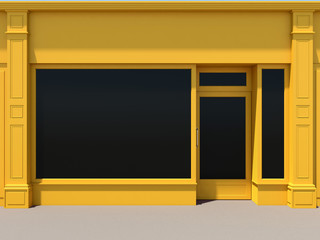 Yellow shopfront with large windows. Yellow store facade.