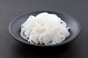 Udon noodles on black dish, Japanese food