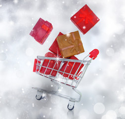 Shopping cart with gift boxes  in a glittery background