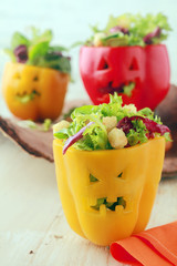 Colorful Halloween food with stuffed peppers