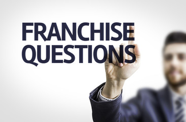 Business man pointing the text: Franchise Questions