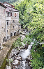 Old mill and stream. Times gone by. Picturesque stone buildings.