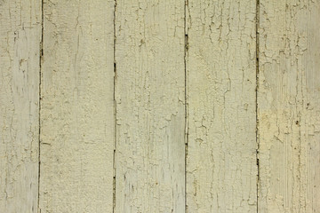 beige wooden planks with peeling paint, texture