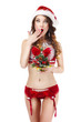 Xmas. Astonished Woman in Santa Claus' Costume. Christmas Gift