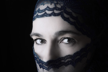 Middle Eastern woman portrait looking sad with blue hijab artist