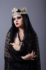 Witchcraft. Woman in Old-Fashioned Clothes and Crown