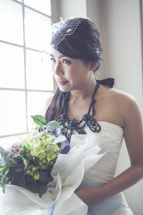 Beauty bride holding bouquet.