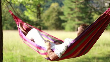Young woman relaxing on hammock-Slow motion-Summer
