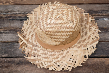 Straw Hat on Wooden Board with vintage