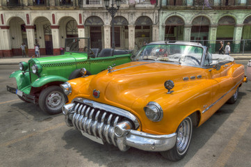 Orange and green cars in front of Capitolio, Havana, Cuba