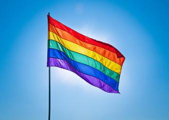 Rainbow Gay Pride Flag on blue sky background
