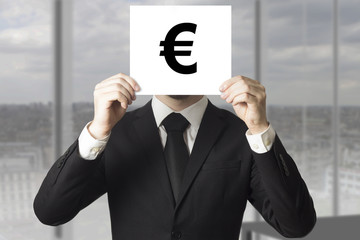 businessman hiding face behind sign euro symbol
