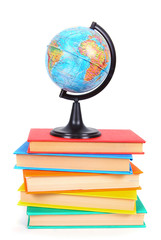 Books and the globe. On white background.