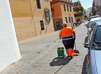 Public cleaning, worker sweeping the street