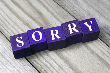 concept of apology, sorry word on wooden cubes