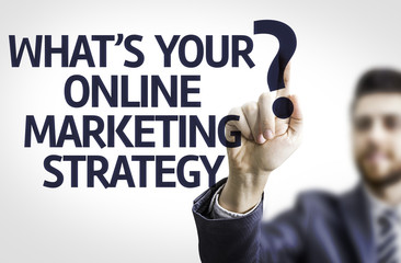 Business man point the text: What's your Online Mkt Strategy?