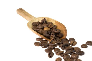 Old wooden spoon with coffee beans on white background