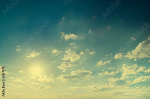 Vintage background in the blue shade with clouds © ZaZa studio
