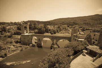 Vintage photo of medieval bridge over river