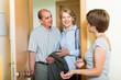 Daughter greeting parents at threshold