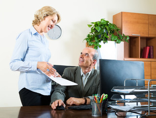 scene of two aged and smiling co-workers