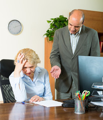 Boss screaming at mature assistant