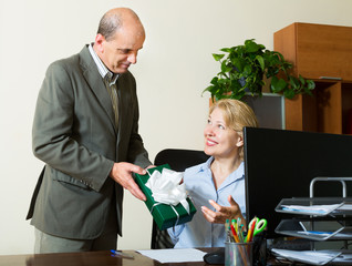 man giving a gift to colleague