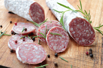 Salami sausage on a wooden cutting board