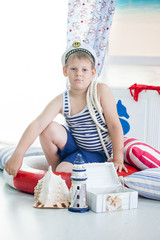 Portrait of a boy sailor playing in the room