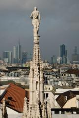 Milan Duomo statue looks at Milano City