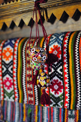 Traditional Ukrainian wooden Easter egg, against the embroidered