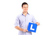 Young man holding a L sign
