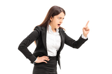 Angry businesswoman threatening with finger