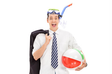 Businessman with diving mask and a beach ball