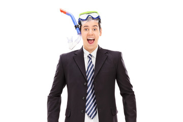 Excited businessman with scuba equipment on him