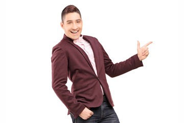 Fashionable smiling guy pointing with hand