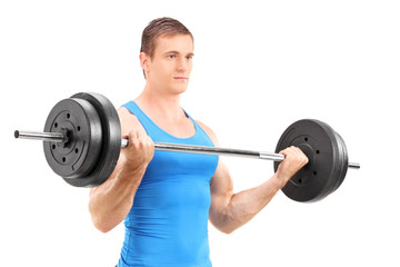 Full length portrait of a muscular bodybuilder lifting a barbell