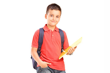 Schoolboy with backpack holding a notebook