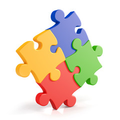 Four assembling colorful puzzle pieces