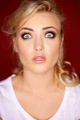 Beautiful woman with a horrified expression