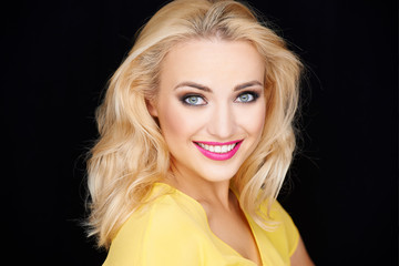 Smiling beautiful blond woman wearing makeup
