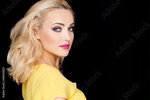 canvas print picture Sexy beautiful blond woman isolated on black