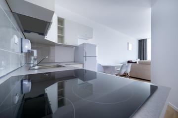 White, small and compact kitchen interior