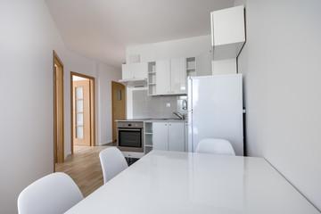 Modern, white compact kitchen interior design