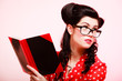 Retro. Pinup girl in eyeglasses reading book